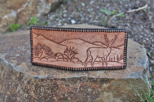 Hand carved heavy leather wallet